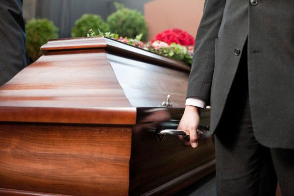 coffin-bearer-carrying-casket-funeral_79405-11769